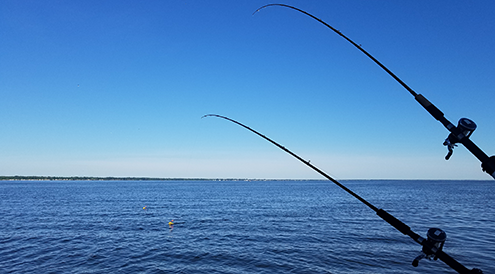Fishing on Saginaw Bay, where Asian carp could devastate the walleye fishery if they invade the Great Lakes.