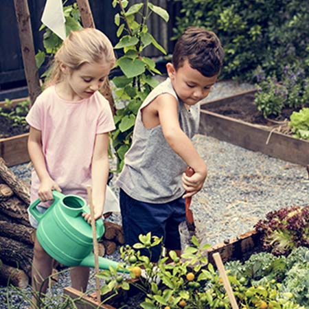 Two children gardening