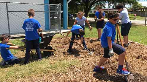 students digging outside