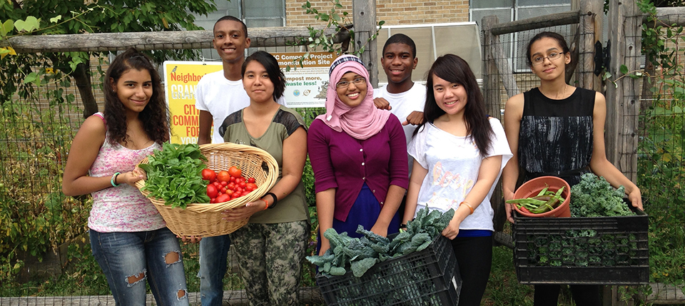 Students holding food from their garden