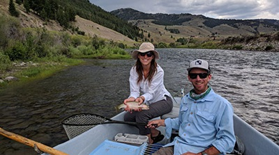 couple fishing in a boat in Sun Valley
