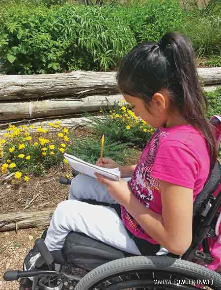 Student conducts an investigation in a Certified Schoolyard Habitat
