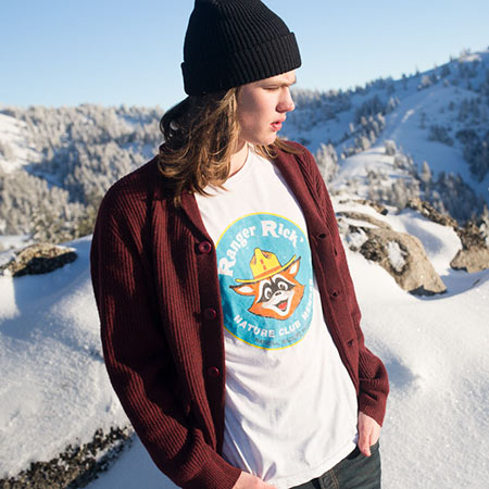 Young man wearing a Ranger Rick Shirt on a snowy mountain