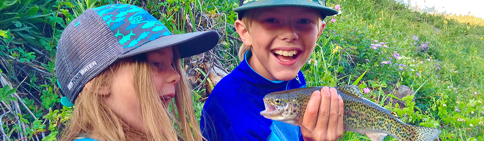 Boy and Girl holding fish